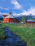 Wallowa County, OR<br /> A red octagonal barn in the Wallowa Valley (built in 1906) with the Wallowa Mountains in the distance