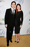 LOS ANGELES, CA. - January 24: Producer Daniel Zelman and actress Debra Messing arrive at the 20th Annual Producer's Guild Awards at the The Hollywood Palladium on January 24, 2009 in Los Angeles, California.