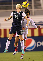 BOCA RATON, FL - DECEMBER 15, 2012: Megan Rapinoe (15) of the USA WNT heads away from Wu Haiyan (26) of China WNT during an international friendly match at FAU Stadium, in Boca Raton, Florida, on Saturday, December 15, 2012. USA won 4-1.