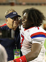 Manatee Hurricanes Leon Allen #7 hugs head coach Joe Kinnan during the fourth quarter of the Florida High School Athletic Association 7A Championship Game at Florida's Citrus Bowl on December 16, 2011 in Orlando, Florida.  Manatee defeated First Coast 40-0.  (Mike Janes/Four Seam Images)