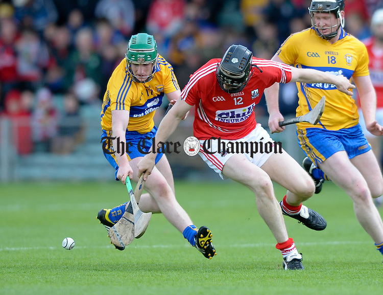 Enda Boyce of Clare in action against Stephen Dineen of Cork during their Munster intermediate championship hurling game in The Gaelic Grounds. Photograph by John Kelly.