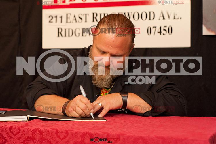 RIDGEWOOD, NJ - JULY 26, 2012: Shawn Crahan of Slipknot, signs copies of his new book ' The Apocalyptic Nightmare Journey' at Bookends in Ridgewood, New Jersey. July 26, 2012. ©Marianne Nicoletti/MediaPunch Inc. /NortePhoto.com<br /> **SOLO*VENTA*EN*MEXICO**<br />  **CREDITO*OBLIGATORIO** *No*Venta*A*Terceros*<br /> *No*Sale*So*third* ***No*Se*Permite*Hacer Archivo***No*Sale*So*third*©Imagenes*con derechos*de*autor©todos*reservados*.