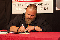 RIDGEWOOD, NJ - JULY 26, 2012: Shawn Crahan of Slipknot, signs copies of his new book ' The Apocalyptic Nightmare Journey' at Bookends in Ridgewood, New Jersey. July 26, 2012. &copy;&nbsp;Marianne Nicoletti/MediaPunch Inc. /NortePhoto.com<br />