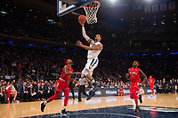 NEW YORK, NY - Thursday March 9, 2017: Josh Hart (#3) of Villanova goes up for a lay-up on Shamorie Ponds (#2) of St. John's as the two schools square off in the Quarterfinals of the Big East Tournament at Madison Square Garden.