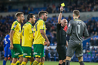 Referee Andy Davies shows a yellow card to Angus Gunn of Norwich City during the Sky Bet Championship match between Cardiff City and Norwich City at the Cardiff City Stadium, Cardiff, Wales on 1 December 2017. Photo by Mark  Hawkins / PRiME Media Images.