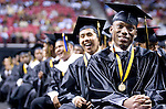 The Gazette. Soon to be Oxon Hill High School graduate Princeuill Achimeeagole listens to the Commencement Speaker with the rest of his graduating class during Oxon Hill High School's graduation ceremony at Comcast Center in College Park on Tuesday afternoon.