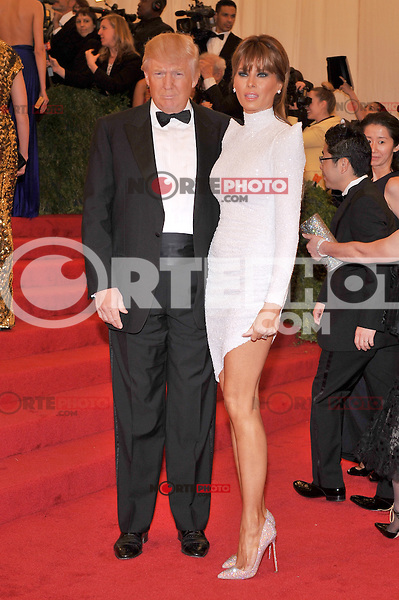 Donald Trump and Melania Trump at the 'Schiaparelli And Prada: Impossible Conversations' Costume Institute Gala at the Metropolitan Museum of Art on May 7, 2012 in New York City. ©mpi03/MediaPunch Inc.