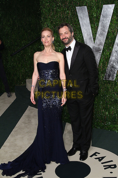 Leslie Mann & Judd Apatow.2012 Vanity Fair Oscar Party hosted by Graydon Carter held at the Sunset Tower, West Hollywood, California, USA..February 26th, 2012.full length strapless dress blue sequins sequined black tuxedo beard facial hair married husband wife .CAP/ADM/SLP/RU.©Ryan Upling/SLP/AdMedia/AdMedia/Capital Pictures.