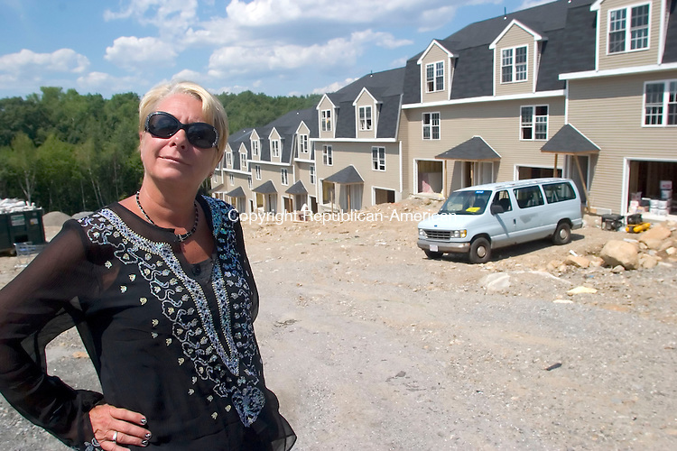 WATERBURY, CT- 17 JULY 2007- 071707JT04-<br /> Developer and realtor Teri Bennett stands in front of Beau View Pointe condominiums under construction in Waterbury on Tuesday, July 17.<br /> Josalee Thrift / Republican-American