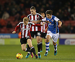 Mark Duffy of Sheffield Utd and George Dobson of Walsall during the English League One match at Bramall Lane Stadium, Sheffield. Picture date: November 29th, 2016. Pic Simon Bellis/Sportimage