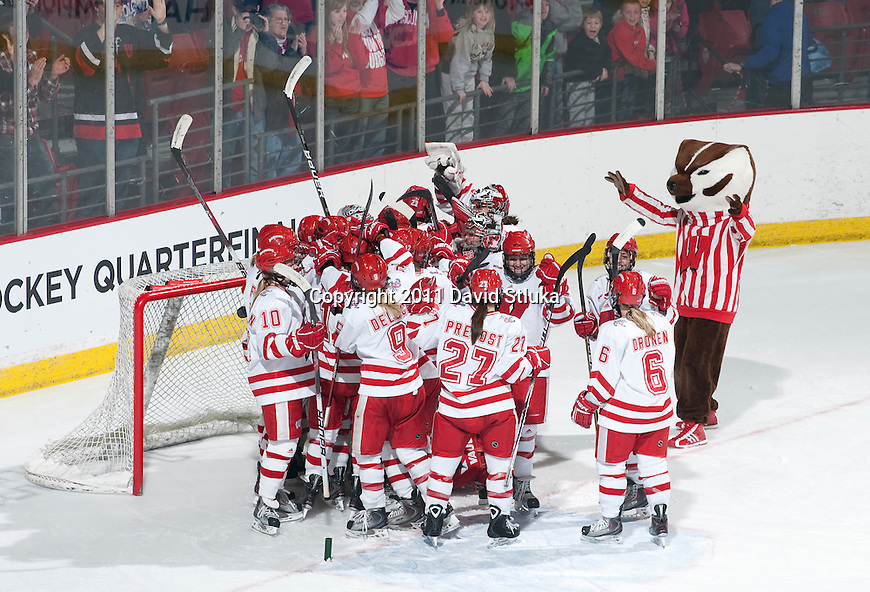 Wisconsin Badgers hockey team celebrates an NCAA tournament victory during a women's hockey game against the Minnesota Duluth Bulldogs at the Kohl Center in Madison, Wisconsin on March 12, 2011. Wisconsin won 2-1. (Photo by David Stluka)