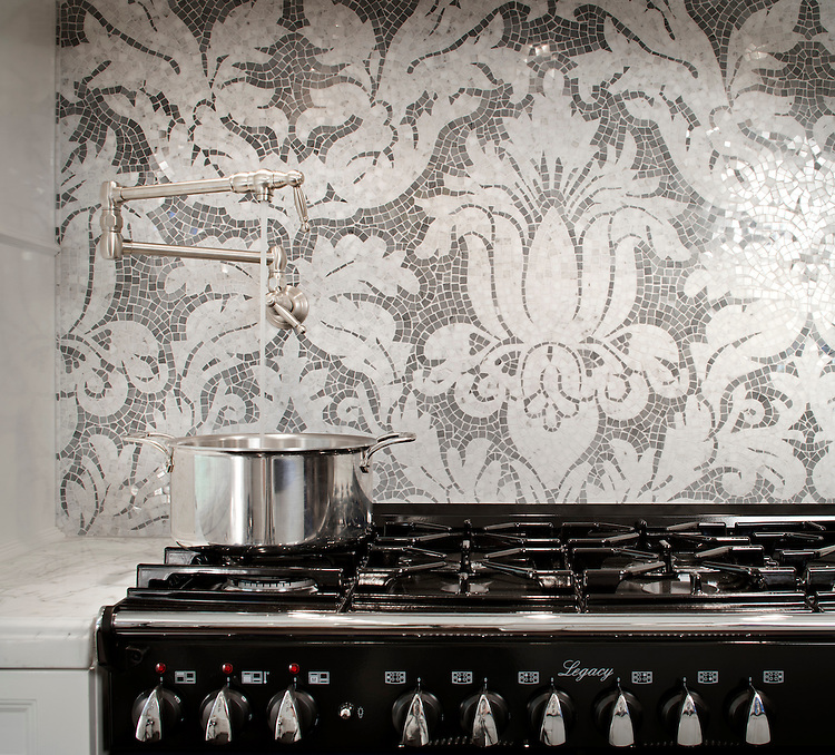 This custom Kingston Lacy backsplash  is shown in polished hand-cut Calacatta Tia and Bardiglio and was designed by Rogers & Goffigon for New Ravenna Mosaics.<br />