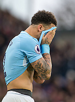 Kyle Walker of Manchester City covers his face during the Premier League match between Crystal Palace and Manchester City at Selhurst Park, London, England on 31 December 2017. Photo by Andy Rowland.