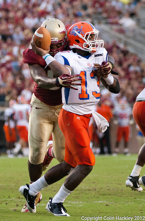 TALLAHASSEE, FL 9/8/12-FSU-SAVANNAH090812CH-Florida State's Giorgio Newberry sacks Savannah State's Antonio Bostick during first half action Saturday at Doak Campbell Stadium in Tallahassee. .COLIN HACKLEY PHOTO