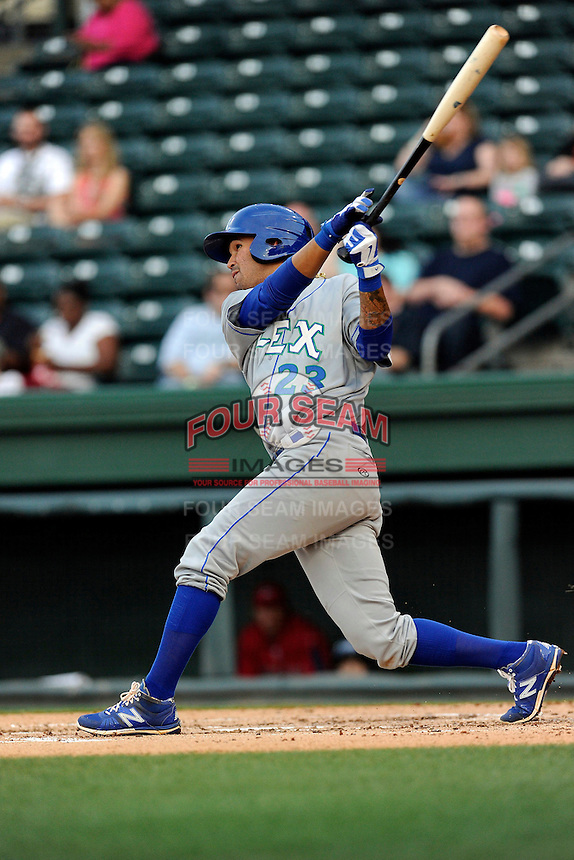 Shortstop Humberto Arteaga (23) of the Lexington Legends bats in a game against the Greenville Drive on Tuesday, April 14, 2015, at Fluor Field at the West End in Greenville, South Carolina. (Tom Priddy/Four Seam Images