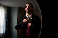 Christopher Soghoian was recently hired as the first technologist for the American Civil Liberties Union.  Soghoian, now a PhD, has worked with think tanks, NGOs and the US Federal Trade Commission on topics relating to privacy and security in technology.  Soghoian is photographed here in his hotel room at the Hyatt Regency in Newport, Rhode Island, while in the city for a security conference.  Soghoian first rose to prominence when he made a website that would create fake airline boarding passes as an illustration of the relative effectiveness of Transportation Security Agency measures in US airports.