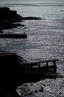Silhouette of man fishing on a jetty.La Caleta, El Hierro, Canaary islands,