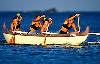 Tiare practicing with her womens outrigger canoe team on the Kona coast , Big Island Hawaii