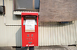 A message on a post box informs residents that postal services have been suspended due to the disaster at the nearby Fukushima No. 1 nuclear power plant in Minami Soma, Fukushima Prefecture, Japan on 30 April 2011..Photographer: Robert Gilhooly