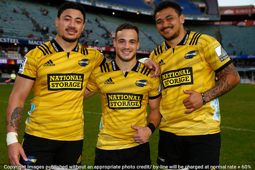 Ben Lam with Wes Goosen and Isaia Walker-Leawere of the Hurricanes during the Super Rugby match between Cell C Sharks and Hurricanes at Jonsson Kings Park Stadium in Durban, South Africa on Saturday, 1 June 2019. Photo by Steve Haag / stevehaagsports.com
