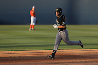 Ryan Drobny (20) of the Cal Poly Mustangs runs the bases during a game against the Cal State Fullerton Titans at Goodwin Field on April 2, 2015 in Fullerton, California. Cal Poly defeated Cal State Fullerton, 5-0. (Larry Goren/Four Seam Images)
