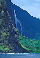 Waterfalls and ocean at pristine Wailau Valley, North shore Molokai