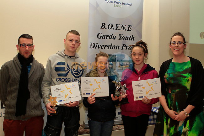 Stephen Harrison and Sinead McCourt present Darren Mulhern, Molly Crosbie and Jessica Woods with Awards for Best Attendance at the Boyne Garda Youth Project Awards in the Holy Family Community Centre...Photo NEWSFILE/Jenny Matthews..(Photo credit should read Jenny Matthews/NEWSFILE)