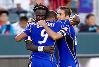 Kansas City Wizards players Kei Kamara and Davy Arnaud celebrate a hug with fellow teammate and goal scorer Teal Bunbury. The Kansas City Wizards defeated CD Chivas USA 2-0 at Home Depot Center stadium in Carson, California on Sunday September 19, 2010.