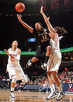 Feb. 7, 2011; Charlottesville, VA, USA; Florida State Seminoles guard Courtney Ward (12) is fouled by Virginia Cavaliers center Simone Egwu (4) as Virginia Cavaliers guard Ataira Franklin (23) looks on during the second half of the game at the John Paul Jones Arena. The Florida State Seminoles won 78-74. Mandatory Credit: Andrew Shurtleff-US PRESSWIRE