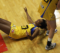 Pulse goal keep Althea Byfield hits her head on the court during the ANZ Netball Championship match between the Central Pulse and Northern Mystics, TSB Bank Arena, Wellington, New Zealand on Monday, 4 May 2009. Photo: Dave Lintott / lintottphoto.co.nz