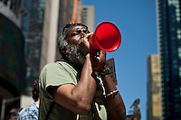 NEW YORK, NY - MAY 01: A man take part  during a march as part of May Day rallies on May 1, 2013 in New York City. Rallies and marches are occuring throughout the city today to mark the day which is traditionally associated with workers movements. (Photo by Kena Betancur).