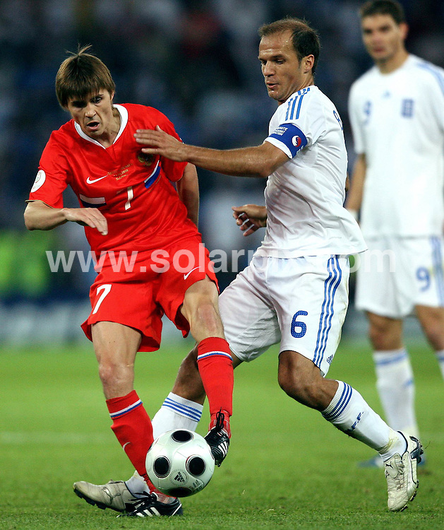 **ALL ROUND PICTURES FROM SOLARPIX.COM**.**SYNDICATION RIGHTS FOR UK AND SPAIN ONLY**.Euro 2008, European Championship 2008, Group C, Match 14, Greece vs Russia, Wals-Siezenheim Stadium, Salzburg, Austria. 14 June 2008. The match ended 1-0 for Russia..This pic: Angelis Basinas and Dmitri Torbinski..JOB REF: 6648 CPR/Ronny Hartmann    .DATE: 14_06_2008.**MUST CREDIT SOLARPIX.COM OR DOUBLE FEE WILL BE CHARGED* *UNDER NO CIRCUMSTANCES IS THIS IMAGE TO BE REPRODUCED FOR ANY ONLINE EDITION WITHOUT PRIOR PERMISSION*