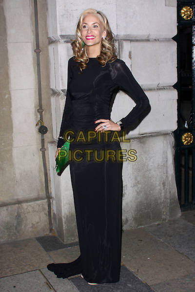 LISA BUTCHER .attending the Women For Women Gala, Banqueting House, London, England, UK, May 5th 2011..full length hand on hip long maxi dress sleeve green clutch bag  black .CAP/AH.©Adam Houghton/Capital Pictures.