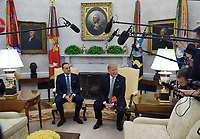 United States President Donald J. Trump, right, speaks as Leo Varadkar, Ireland's prime minister, listens during a meeting in the Oval Office of the White House in Washington, D.C., U.S., on Thursday, March 14, 2019. <br /> Credit: Olivier Douliery / Pool via CNP/AdMedia
