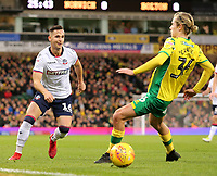 Bolton Wanderers' Pawel Olkowski plays the ball past Norwich City's Todd Cantwell<br /> <br /> Photographer David Shipman/CameraSport<br /> <br /> The EFL Sky Bet Championship - Norwich City v Bolton Wanderers - Saturday 8th December 2018 - Carrow Road - Norwich<br /> <br /> World Copyright &copy; 2018 CameraSport. All rights reserved. 43 Linden Ave. Countesthorpe. Leicester. England. LE8 5PG - Tel: +44 (0) 116 277 4147 - admin@camerasport.com - www.camerasport.com