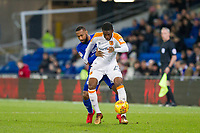 Fikayo Tomori of Hull City protects the ball from Junior Hoilett of Cardiff City during the Sky Bet Championship match between Cardiff City and Hull City at the Cardiff City Stadium, Cardiff, Wales on 16 December 2017. Photo by Mark  Hawkins / PRiME Media Images.