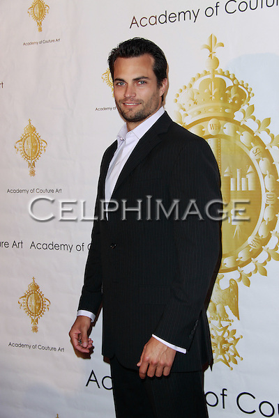 SCOTT ELROD. Attending the Premiere Grand Fashion Gala: Collide 2010, honoring Princess Theodora of Greece & Denmark, presented by the Academy of Couture Art at the Sofitel Grand Ballroom. Beverly Hills, CA, USA. July 24, 2010.