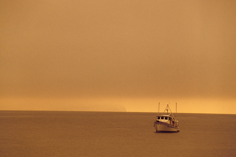 Boat anchored in Penn Cove in fog, Ebey's Landing National Historic Reserve, Coupeville, Whidbey Island, Washington
