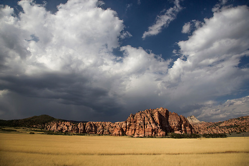 Threatening clouds pass over Cave Valley at Zion National Park, Utah