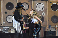 SHEPTON MALLET, ENGLAND - JUNE 30: Billy Ray Cyrus and Miley Cyrus performing at Glastonbury Festival, Worthy Farm, Pilton, on June 30, 2019 in Shepton Mallet, England.<br /> CAP/MAR<br /> ©MAR/Capital Pictures