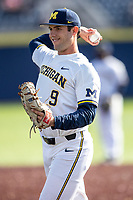 Michigan Wolverines first baseman Matthew Schmidt (9) warms up before the NCAA baseball game against the Rutgers Scarlet Knights on April 26, 2019 at Ray Fisher Stadium in Ann Arbor, Michigan. Michigan defeated Rutgers 8-3. (Andrew Woolley/Four Seam Images)