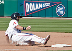 Reno Aces runner Adam Eaton slides safely back into first against the Tacoma Rainiers in their game played on Monday, May 7, 2012 in Reno, Nevada.