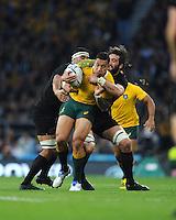 Israel Folau of Australia is tackled by Samuel Whitelock of New Zealand during the Rugby World Cup Final between New Zealand and Australia - 31/10/2015 - Twickenham Stadium, London<br /> Mandatory Credit: Rob Munro/Stewart Communications