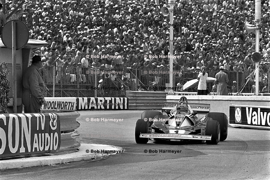 MONTE CARLO, MONACO - MAY 30: Niki Lauda of Austria drives the Ferrari 312T2 026/Ferrari 015 en route to victory in the Grand Prix of Monaco FIA Formula 1 race at the Circuit de Monaco temporary street circuit in Monte Carlo, Monaco on May 30, 1976.