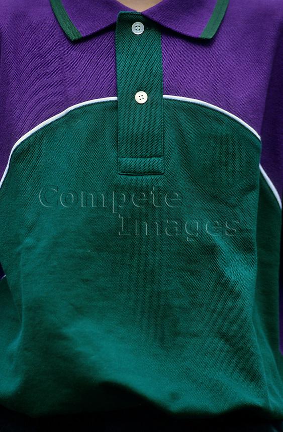 Ball boy wearing a Wimbledon official shirt