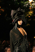 Marie Saint-Pierre night time runway fashion show in Montreal, black dresses and big hats