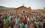 Children leave Catholic Mass in Lugi, a village in the Nuba Mountains of Sudan. The area is controlled by the Sudan People's Liberation Movement-North, and frequently attacked by the military of Sudan.