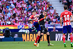 Jose Maria Gimenez of Atletico de Madrid (L) fights for the ball with Enrique Garcia of SD Eibar (R) during the La Liga match between Atletico Madrid and Eibar at Wanda Metropolitano Stadium on May 20, 2018 in Madrid, Spain. Photo by Diego Souto / Power Sport Images