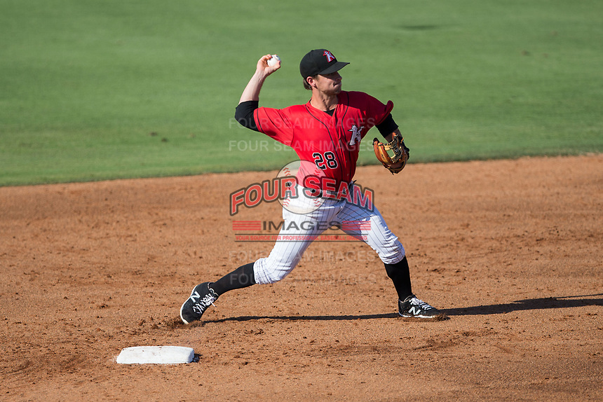 Kannapolis Intimidators shortstop Grant Massey (28) makes a throw to first base against the Hagerstown Suns at Kannapolis Intimidators Stadium on June 14, 2017 in Kannapolis, North Carolina.  The Intimidators defeated the Suns 4-1 in game one of a double-header.  (Brian Westerholt/Four Seam Images)