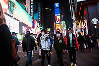 "NEW YORK, NEW YORK - MARCH 5: Young people wear facial masks while walking through Times Square on March 5, 2020. in New York City. New York State has 44 people in quarantine, some 4,000 people are in ""precautionary"" quarantine in more than two dozen counties, including more than 2,700 in the city and 1,000 in Westchester, Cuomo said. (Photo by Pablo Monsalve / VIEWpress via Getty Images)"